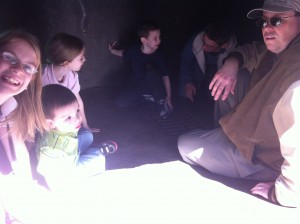 Scott went with the kids inside a small cave.