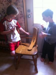 Hannah and Jonathan fixing a broken chair.