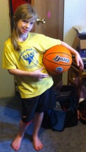 Hannah and her new basketball.