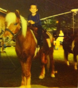Joshua riding a pony when he was about 3 years old.